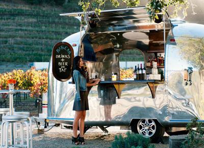 An Airstream trailer with a liquor license